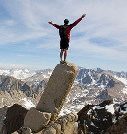 man-on-top-of-mountain-slab-arms