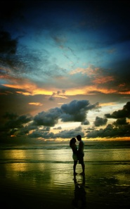 couple-on-beach-beautiful-sky