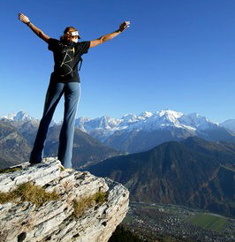 woman-on-mountain-top-joy-greatnessGirl Standing On Top Of A Mountain