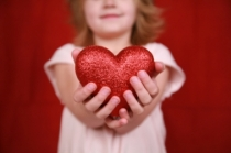 little-girl-holding-heart