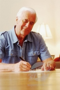elderly-man-writing-a-letter