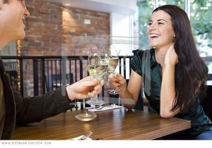 man-and-woman-clinking-glasses-in-restaurant