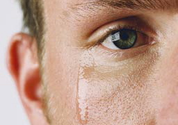 close-up-of-mans-eye-crying