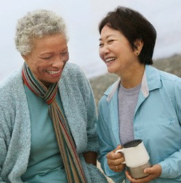 two-women-talking-and-smiling