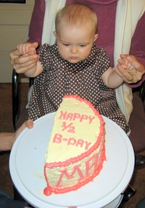 baby-with-half-birthday-cake