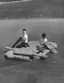 two-boys-playing-on-a-raft