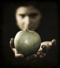 woman-holding-out-green-apple-resisting-temptation-cravings