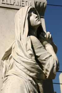 stone-statue-of-grieving-woman
