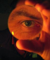eye-magnifying-glass-held-in-hand