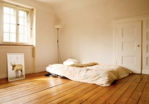 bed-empty-room-bare-walls