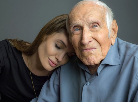 "Louis Zamperini with Angelina Jolie, who will be directing the movie version of ""Unbroken"""