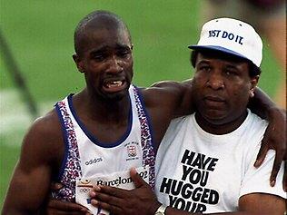 Derek Redmond's dad, Jim, helps his son cross the finish line