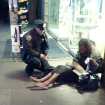 New York City police office LarryDePrimo buys a pair of boots for a barefoot man in need
