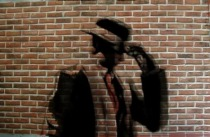 silhouette-stranger-hat-brick-wall