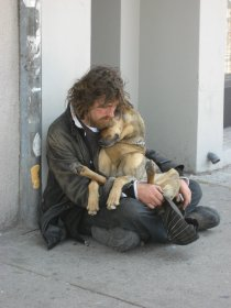 homeless-man-holding-dog