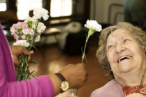 offering-flower-to-elderly-woman