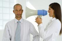 woman-megaphone-man-criticizing