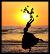 silhouette-woman-rejoicing-on-beach-hlding-butterflies
