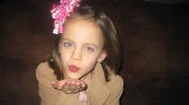 little-girl-blowing-a-kiss